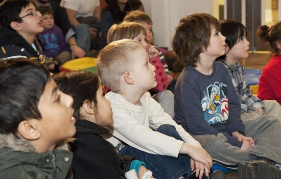 A group of children listen during a storytelling session at the Science Museum