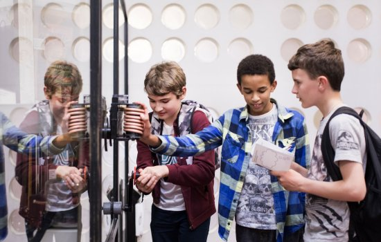 Students interact with exhibits in the Secret Life of the Home gallery at the Science Museum, London