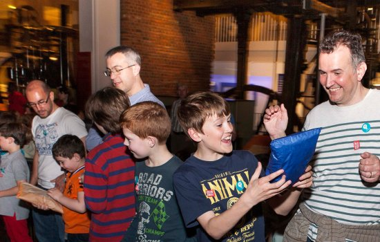 Image shows family visitors at a Science Night event