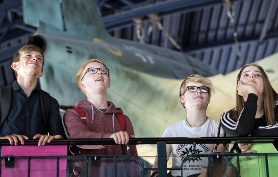 A group of students in the Flight gallery at the Science Museum, London
