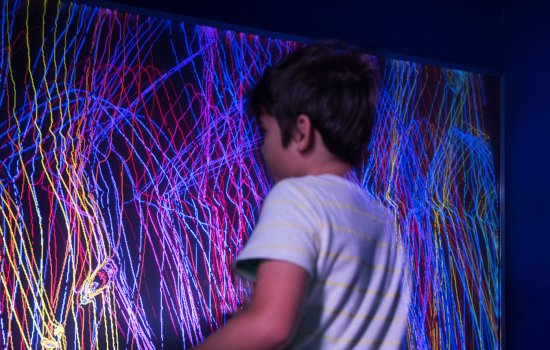A young boy plays in Pattern Pod at the Science Museum