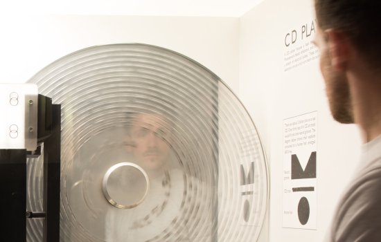 A man looks at a CD player in the Secret Life of the Home gallery at the Science Museum