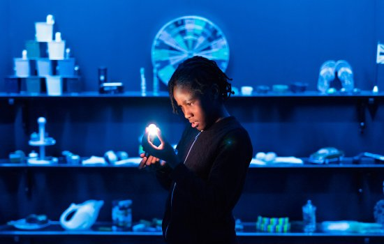 A young person holds a torch in Wonderlab: The Statoil Gallery