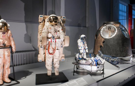 Space suits on display in the Cosmonauts exhibition