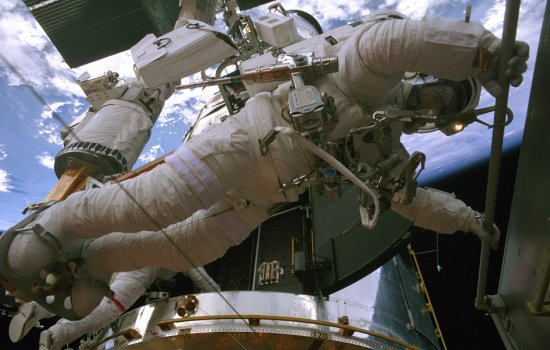 Astronaut on a space walk to repair the Hubble Space Telescope
