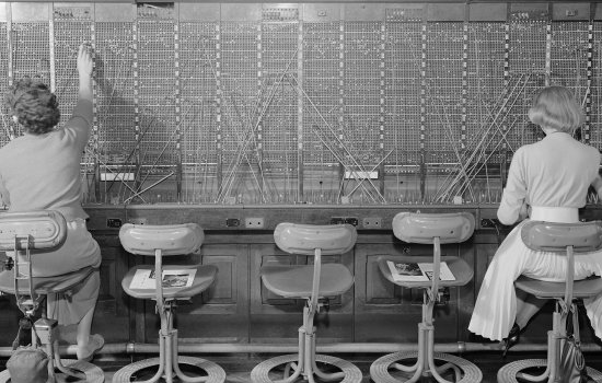 Two female switchboard operators at work at Enfield telephone exchange, 1960