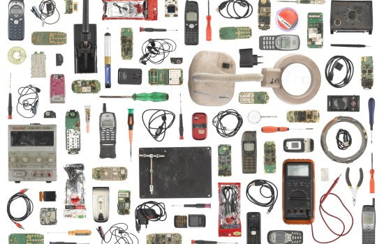 Parts from a mobile phone repair workshop in Buea, Cameroon, 2012, laid flat on a white background
