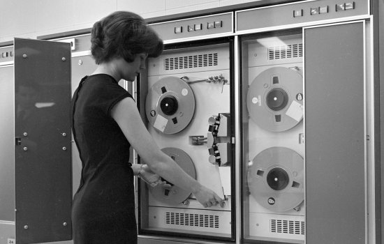 A woman operating a large computer, c. 1960s