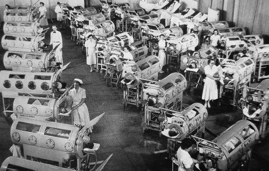 A ward full of dozens of iron lungs for polio patients