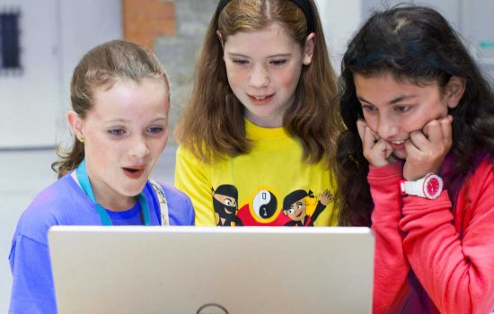 Girls learning code at CoderDojo course