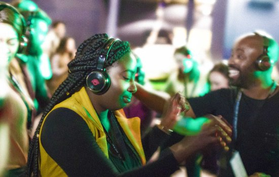 Visitors dancing in the SIlent Disco at Lates