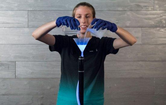 Science Museum Explainer performing the Liquid Light experiment in Wonderlab The Equinor Gallery