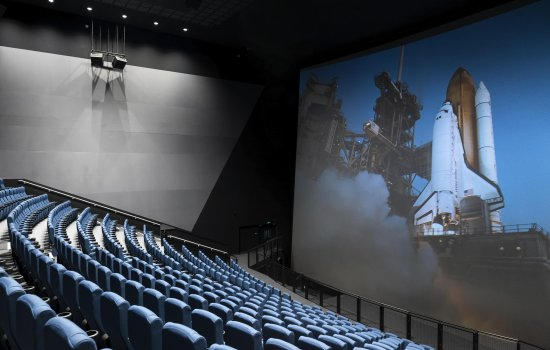 IMAX The Ronson Theatre auditorium with a view of the screen showing a rocket launch