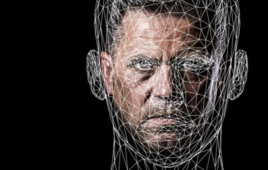A man's face with a digital grid over the top of it