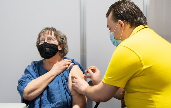 Jean Adkins becomes the first person to receive the coronavirus vaccine at the Science Museum NHS Vaccination Centre