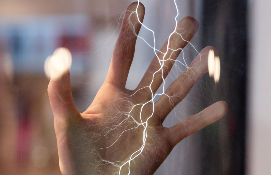 A hand touches the Lightning Strike experiment in Wonderlab