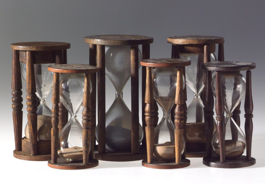 Six 18th-century sand glasses in wooden mounts