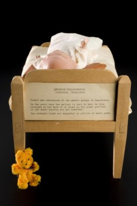 A doll in a model bed used to explain treatment to children with polio
