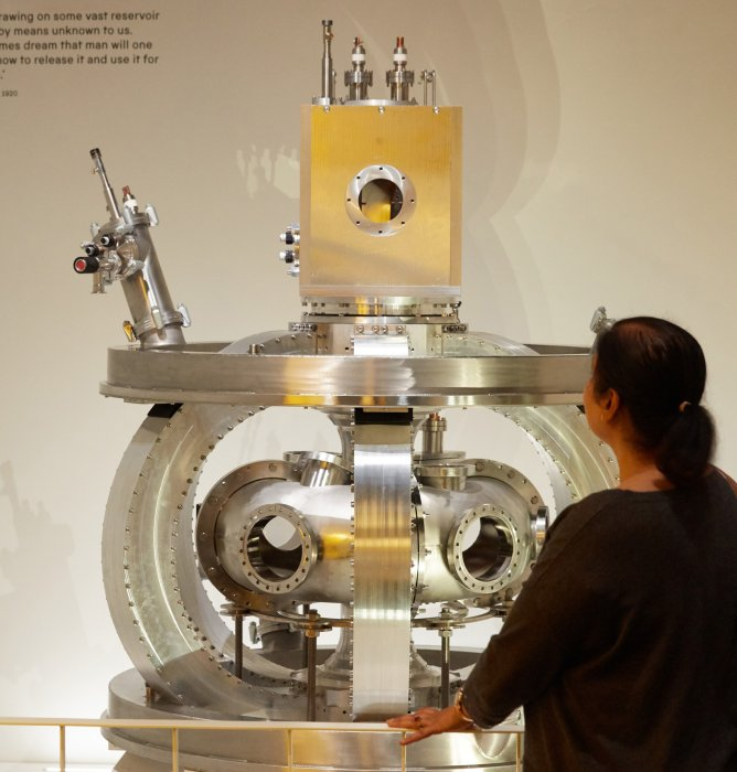 A visitor looks at a nuclear fusion device in the Sun exhibition