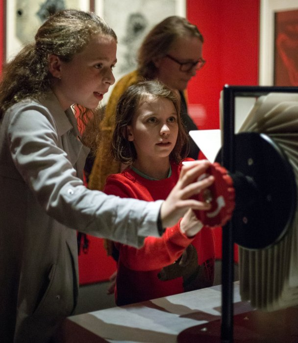 Two children looking at an exhibit in the Sun exhibition at the Science Museum
