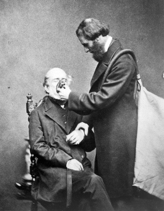 Joseph Clover (1825-1882) demonstrating his anaesthetic apparatus on a seated man