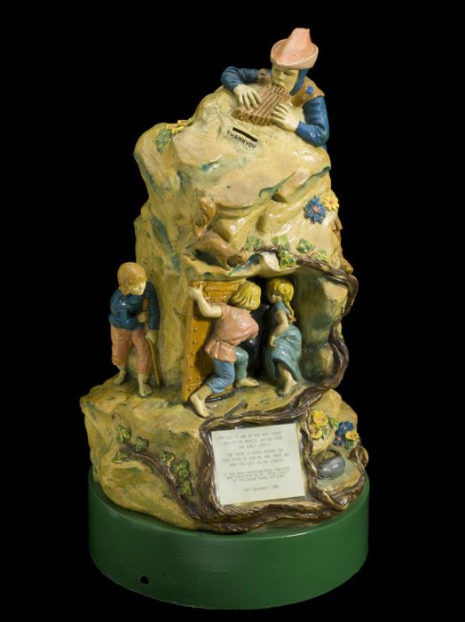 A collection box for polio on the theme of the Pied Piper of Hamlin farytale.