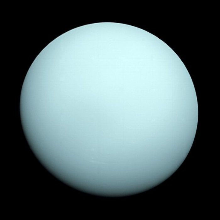 Pale blue planet on a black background