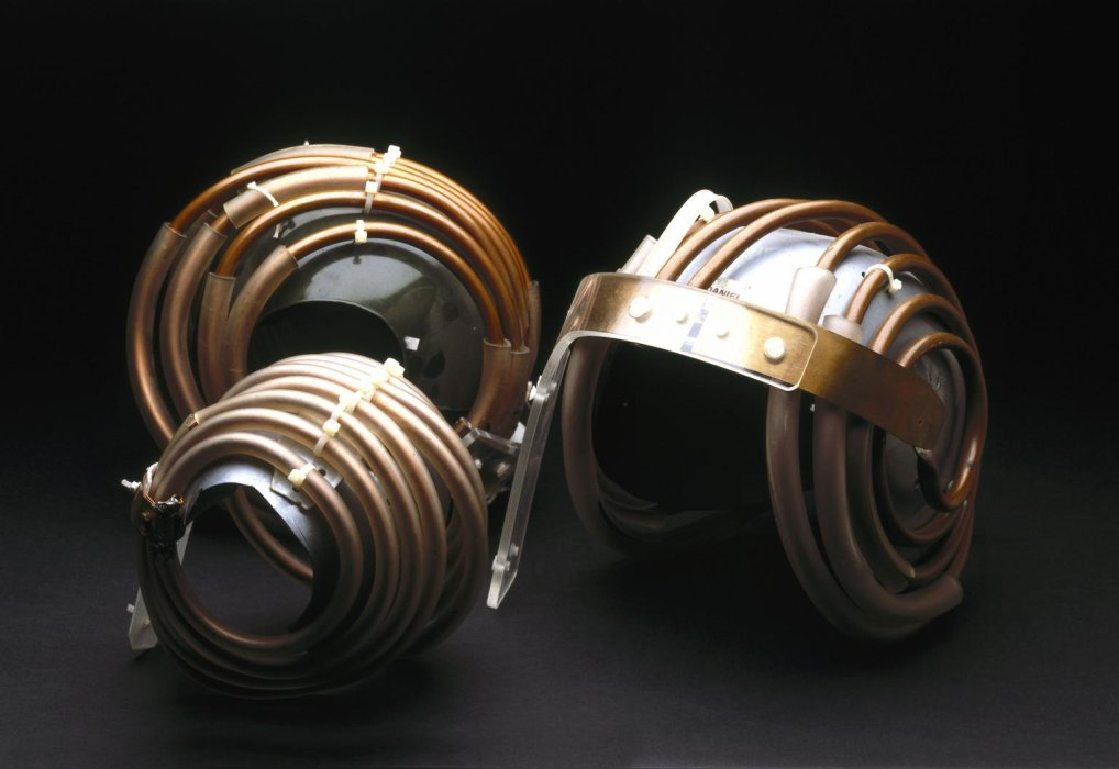 Group of 'Jedi' helmets for use in MRI scanning of the brain, 1984. General view. Black background.