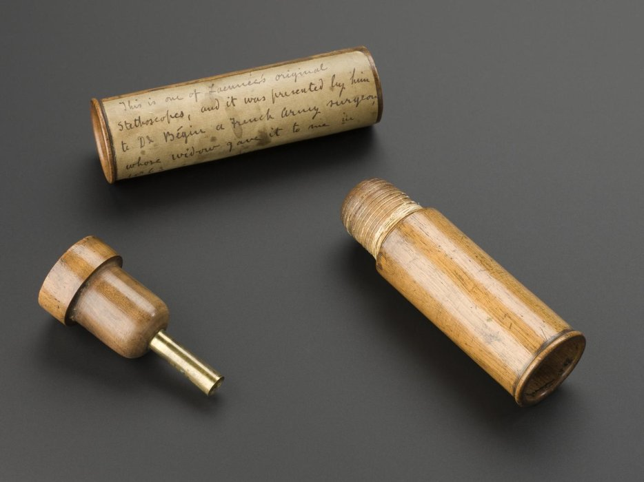 Laennec stethoscope made by Laennec, c.1820. Front 3/4 view of whole object against graduated grey background