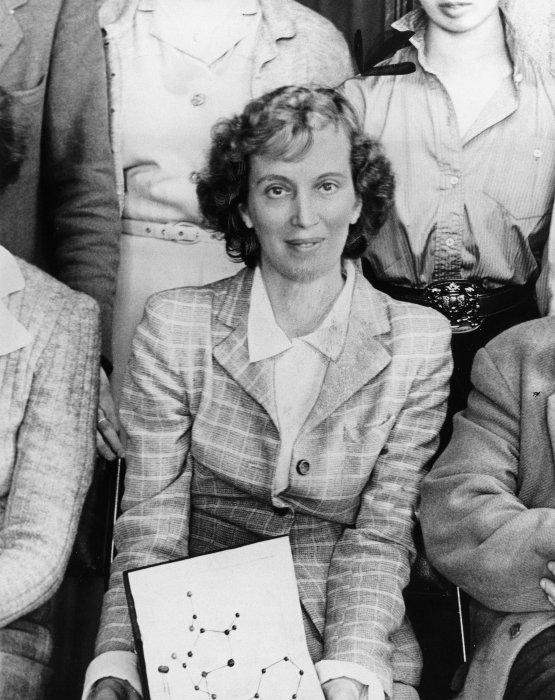 Dorothy Hodgkin sitting with a molecular model on her knees