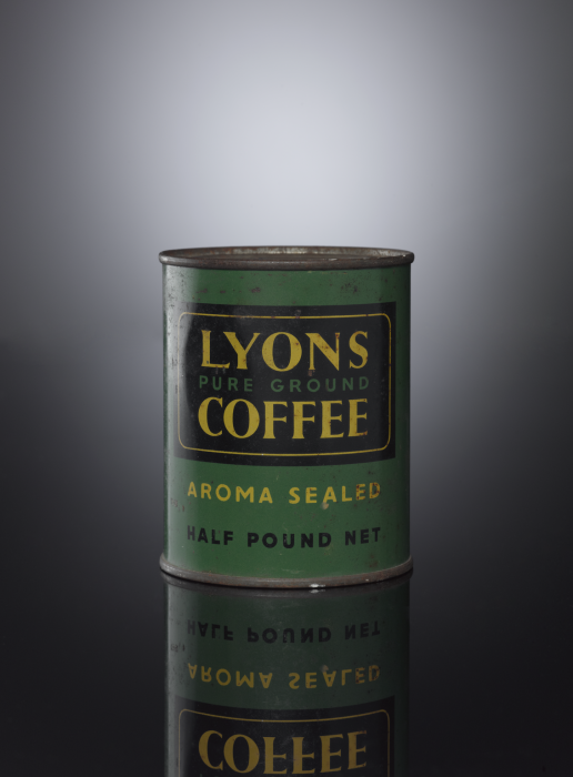 Green and black cylindrical tin against a dark grey background