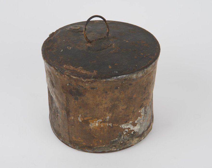 Rusty metal tin against a white background