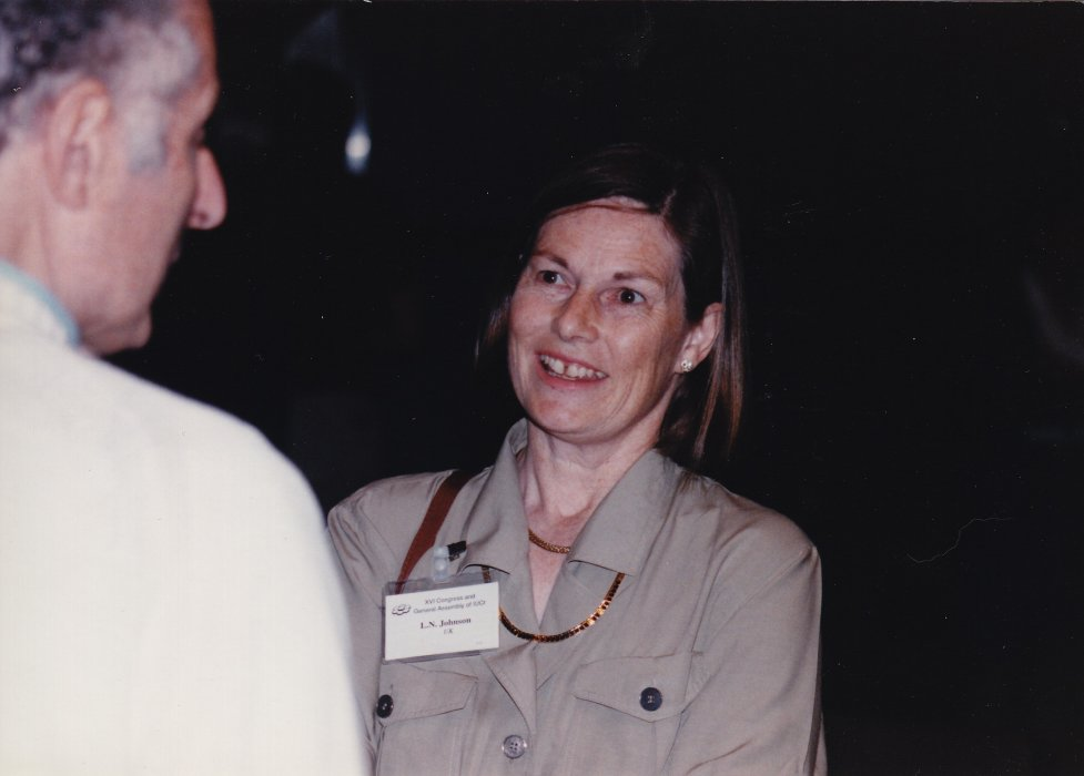 Louise Johnson smiles at a man with his back to the camera