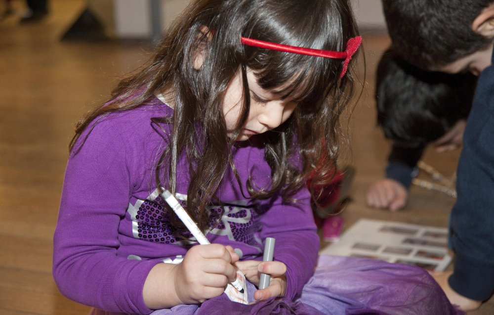 A young girl colouring in at a workshop at the Science Museum