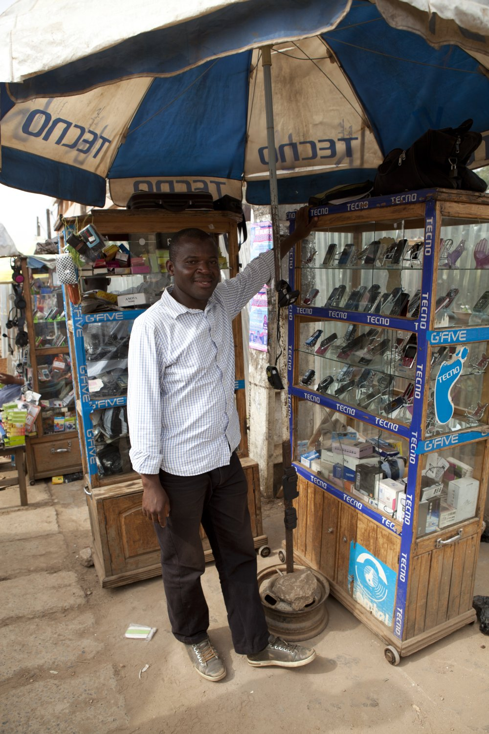Entrepreneur Roger Nche with his call box in Bamenda, Cameroon