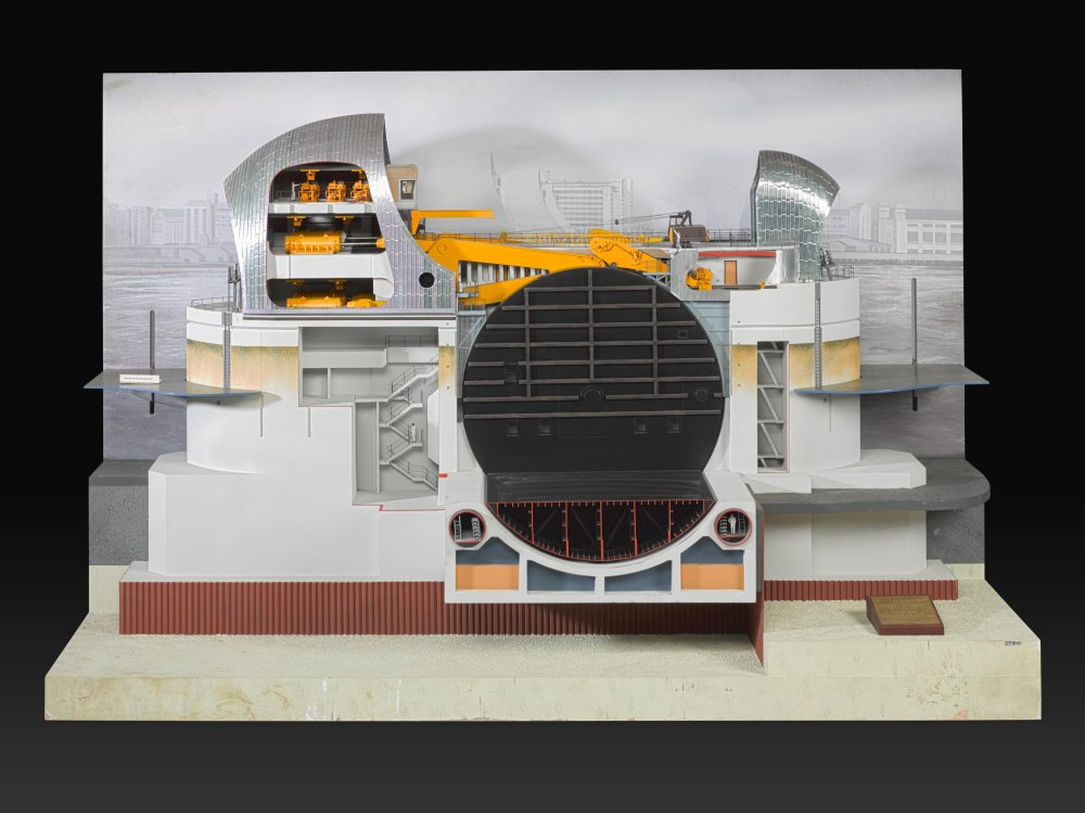 Sectioned model of the Thames flood barrier against a black background