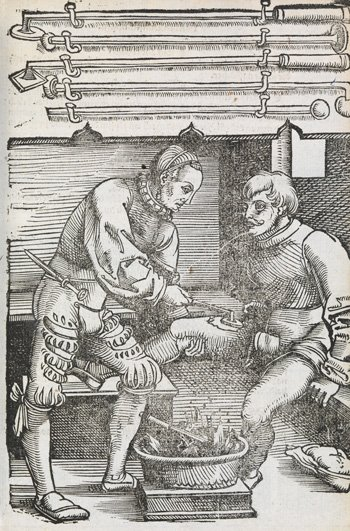 A surgeon cauterising a man's wound with a hot iron in front of a fire