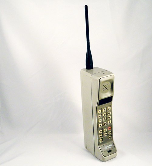 A grey Motorola DynaTAC mobile phone, against a white background