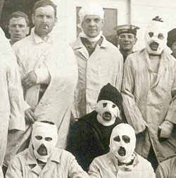 Wounded men, some with facial bandages on a hospital ship in WW1