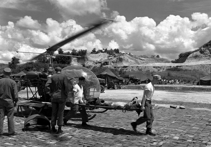 A wounded soldier being stretchered off a helicopter in the Korean War
