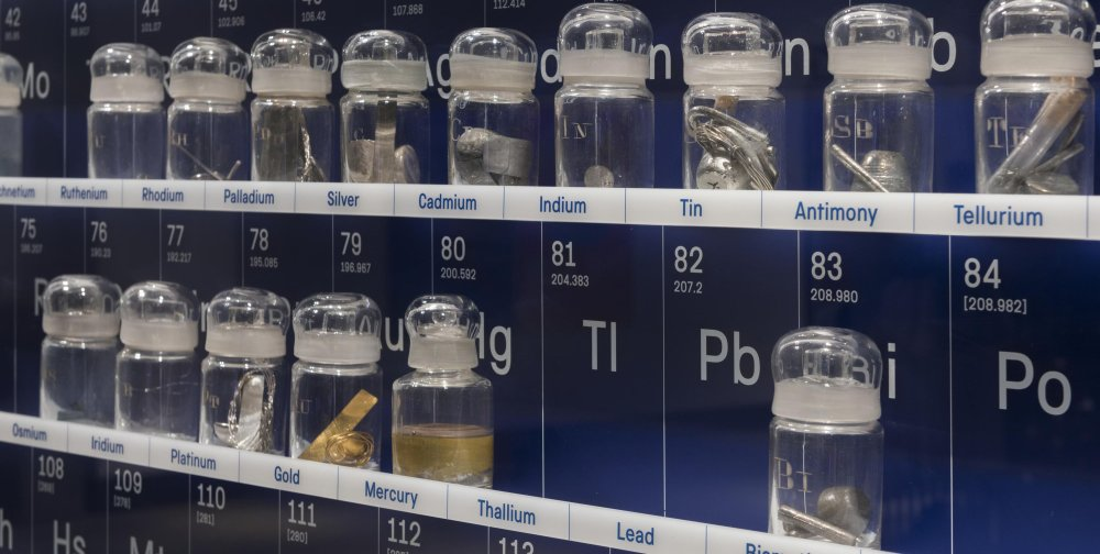 An detail of the Periodic Display at the Science Museum showing a row of jars each containing a different element