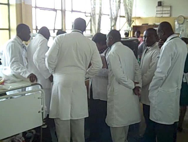 Medical students crowded around a hospital bed during ward round
