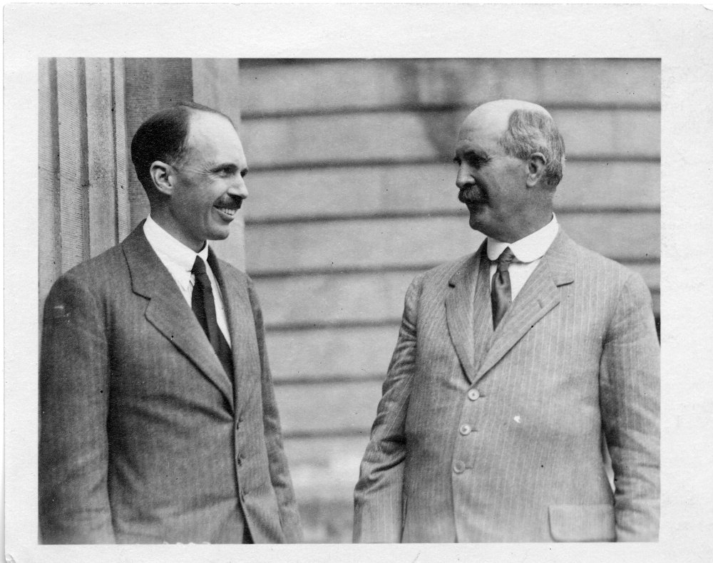 Lawrence and W H Bragg stand together smiling